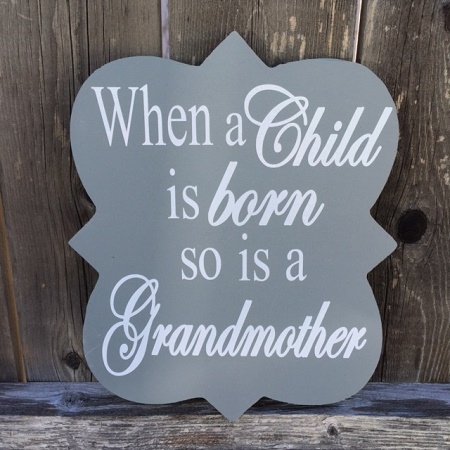 When a Child is Born so is a Grandmother Wood Sign